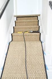 installing a seagrass stair runner white painted staircase makeover with seagrass stair runner tutorial