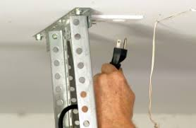 how to fix a garage door springHow to Replace Garage Door Torsion Springs