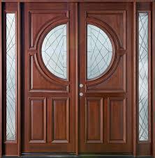 large brown wooden double doors combined wiyh half round glass on the middle plus glass sidelights