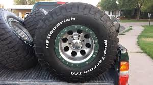 4- 33X12.5X15 BF Goodrich Mud Terrain T/A KM2 tires on Mickey ...