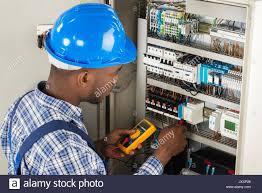 man testing fuse box stock photos & man testing fuse box stock testing car fuse box with multimeter at Testing Fuse Box With Multimeter
