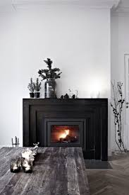 white room with a black fireplace