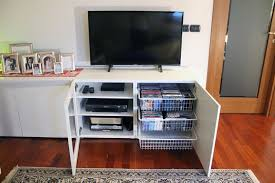 this clever white tv stand hides a heap