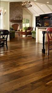 dark hardwood floors are a favorite but what are the pros and cons before you and install a dark brown wood floor read this