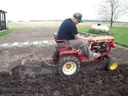 bush hog garden tractor plowing