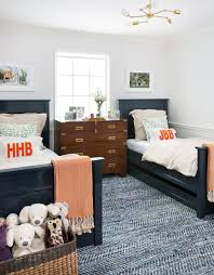 Double twin beds and patterned textured rug