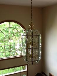 2 story foyer chandelier how high to hang in