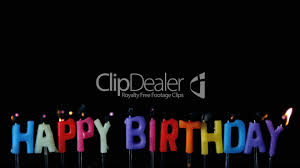 Colourful Happy Birthday Candles Being Blown Out With Copy Space On