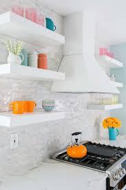 thomasville vent hood mosaic backsplash and floating shelves in newly remodeled kitchen