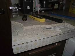 removing tile from a laminate countertop