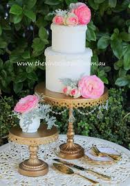 gold crystal chandelier cake pedestal with gold plated cake knife server