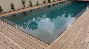 modren pool teak decking installation around swimming pool with fasteners on deck around pool o