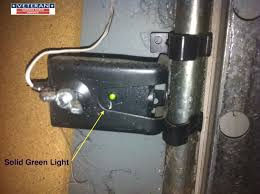 the light on one of the safety eye sensors on my garage door opener is not solid what should i do