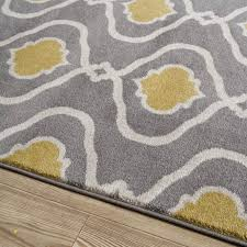 gray and yellow area rug for household