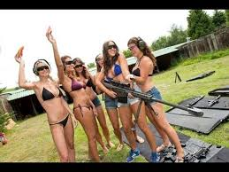 Naked women firing guns