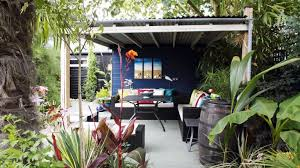 looking for garden ideas covered garden pergola with blue wall in caribbean inspired garden