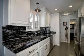 lighting for galley kitchen. small traditional galley kitchen with white raised panel cabinets and black space granite counter lighting for g