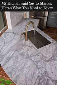 my carrara marble kitchen and tips for choosing marble countertops