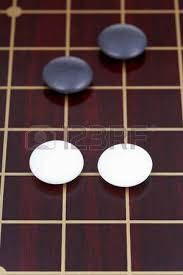 Game With Stones And Wooden Board Go Game Playing By Stones On Wood Go Board Stock Photo Picture 64