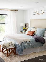 You may want to rethink your black-out window treatments. Embrace natural  light, which will help a small bedroom feel light and airy.
