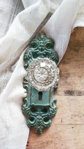 colored glass door knobs. i love the shape of door knob holder and antique look with glam crystal knob. aqua color. door\u2026 colored glass knobs w