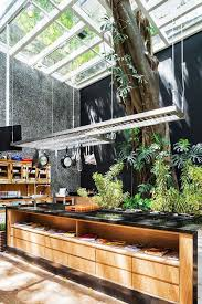 indoor outdoor kitchen with garden decor