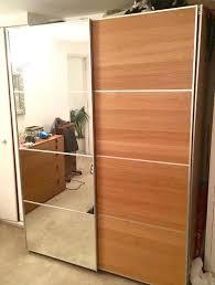 ikea pax wardrobe with half mirrored glass half ilseng oak sliding doors 18 mts old