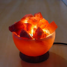 lighting a bowl. A Stunning Natural Himalayan Rock Salt Fire Bowl With Loose Crystals For Warm Mood Lighting Soothing Health Benefits. Read More. N