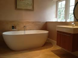 chic freestanding bathtub and tile design with duravit vanity and floating vanity