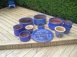 blue ceramic garden pots feet tray