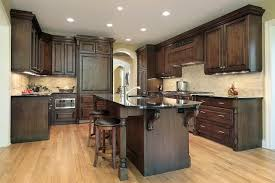Dark flooring and cabinets with an authentic arrangement of kitchen appliances create a strong look and a relaxing tone that's common with traditional setups. 17 Flooring Options For Dark Kitchen Cabinets