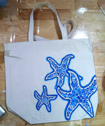 i made a quick sketch of starfish and then we went to town painting we used three colors of blue fabric paint light um and dark