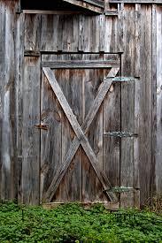 antique photograph rustic old wooden barn door by heather reeder