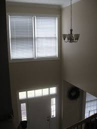 the bottom of the windows is 12 feet up what size chandelier should i look for height and width and how high should we hang it