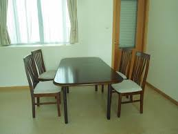 walnut wooden dining table with four chairs