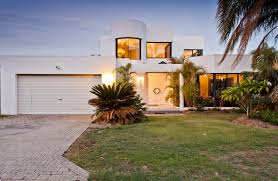 View in gallery Contemporary white stucco home