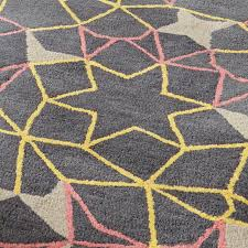 these spectrum rugs have a geometric arrows and stars design throughout and are made from 100 wool these stylish rugs are sure to create a cool