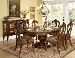dining room with awesome round table design plus metal chandelier also luxury rectangular rug and carving