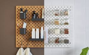 A side-by-side image of a brown pegboard in a bathroom and a