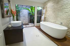 tropical bathroom design with private outdoor shower