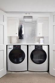 In this small laundry closet, not an inch of space is wasted. A countertop