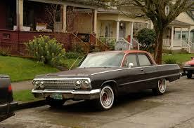 OLD PARKED CARS.: 1963 Chevrolet Biscayne.