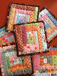 How to make potholders from all the scraps you just can't throw ... & I love all the colors and, in my opinion, we all need a pile of fun quilted  pot holders! In christmas colors for gifts. Adamdwight.com