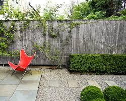 pea gravel patio garden red chair
