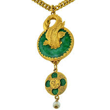 this beautiful 22k yellow gold and jade necklace and pendant features a gold koi fish swimming