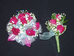 wrist corsage with hot pink spray roses baby breath with hot pink leaves and