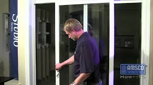 adjusting the rollers on a sliding patio door you