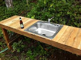 rustic outdoor kitchen table with sink