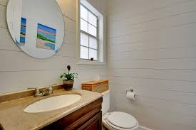 and not even like a master bathroom with a waterfall shower and a huge tub yeah really just a powder room and i can sum up why in one word shiplap