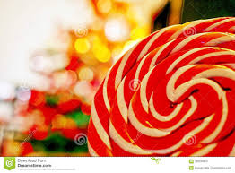 Candy Christmas Lights Striped Lollipop Candy With Christmas Lights Background